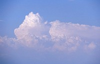 A tropical thunderhead promises rain as storm clouds build in the sky.