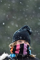 A 10_year_old spends time outside during the seasons first snow.