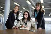 Business women smiling in office.