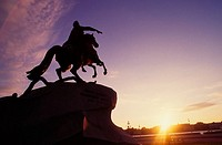Russia, St Petersburg, statue of bronze horseman at sunset, low angle view