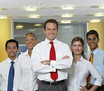 Portrait of five business people in office, smiling