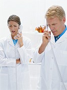 Two doctors using telephone