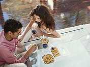 Young couple dining at restaurant, elevated view