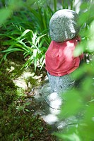 Stone statue in Japanese ornamental garden