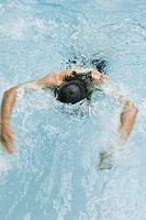 Man swimming in pool, head down (thumbnail)