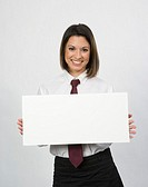 Portrait of young office worker holding sign