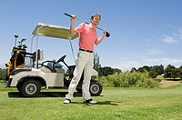 A golfer holding a golf club