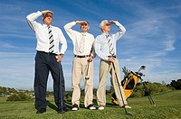 Businessmen playing golf
