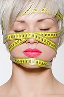 Woman with tape measure around her head