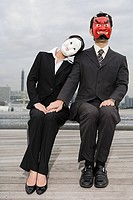 Businesspeople wearing masks