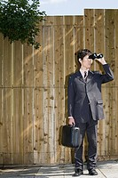 A businessman using binoculars