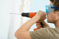 Man drilling wall