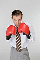 Man wearing boxing gloves with suit