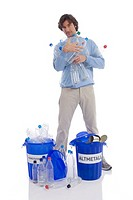 Man with plastic bottles and dust bin