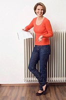 Woman holding utility bill