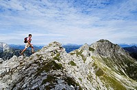 Austria, Salzburger Land, young man hiking