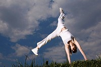 Young woman doing headstand