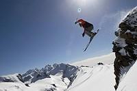 Italy, Matterhorn, Cervinia, snowboarder jumping