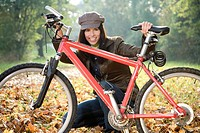 Young woman with bike, portrait