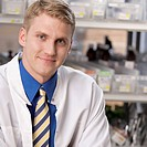 Portrait of a male pharmacist in a medical store