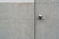 Close_up of a security camera on a wall