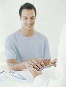 Young man having nails filed