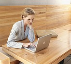 Businesswoman using laptop, elevated view