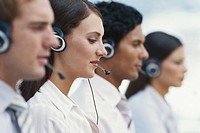 Young men and women working in call centre