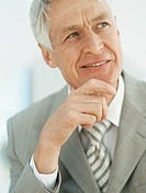 Senior businessman looking away and smiling,close_up