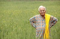 Farmer in field, hands on hips