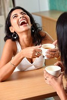 two young woman having coffee