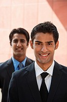 two businessmen smiling vertical