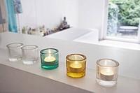 still life of three candles in a bathroom