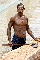Woodsman making dug out in the river, Indonesia