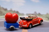 Miniature doll and car with heart