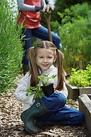 Girl 5-6 in garden with mother portrait (thumbnail)