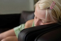 Close_up of girl 7_9 sleeping on sofa
