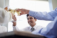 Business associates toasting with wine glasses close_up