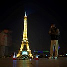 People standing by Eiffel tower