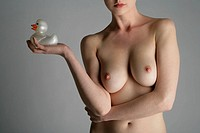 Cropped view of a nude woman with a rubber duck