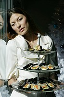Woman holding a tiered platter
