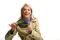 Mature woman holding a mug