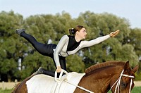 Vaulting lady during the compulsory exercise flag Germany