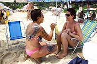 Beach, Tattooed woman, Praia do Lagoinha, Florianopolis, Santa Catarina, Brazil.
