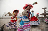 Children in traditional costume dancing at Yanque, Colca Canyon, Peru