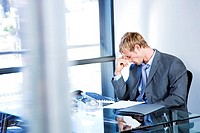 Businessman looking stressed in a modern office