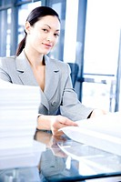 Businesswoman behind a desk with paperwork