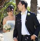 Confetti over a bride and groom
