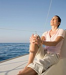 A woman relaxing on a boat
