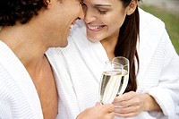 Woman and a man celebrating with champagne and being affectionate